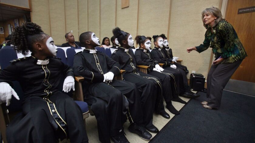 Councilmember Lorie Zapf talks with members of the St. Stephens T.R.U.T.H. (To Reach Up To Heaven) Gospel Mime Group before they performed for the San Diego City Council on Tuesday.