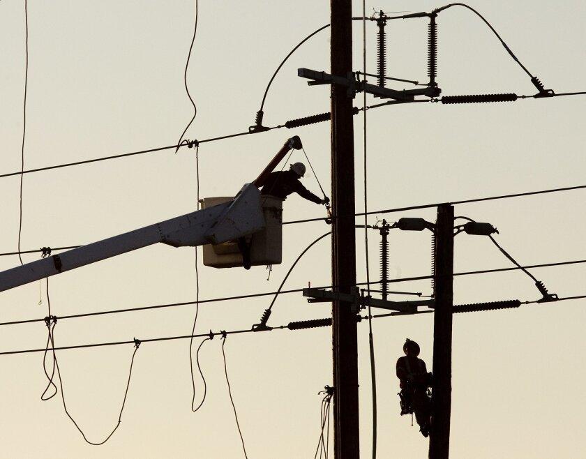 San Diego Gas & Electric linemen work on a power line in Kearny Mesa.