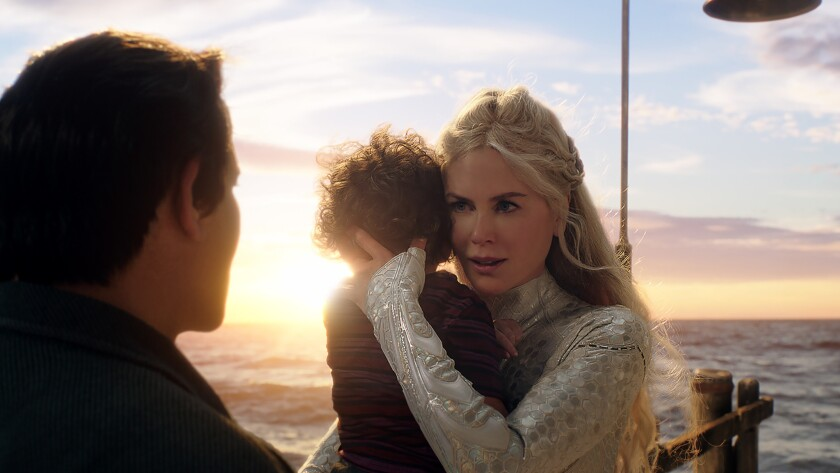 (L-r) TEMUERA MORRISON as Tom Curry and NICOLE KIDMAN as Atlanna in Warner Bros. Pictures? action ad