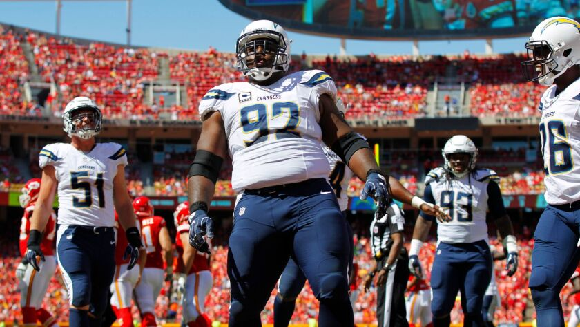 San Diego Chargers Brandon Mebane celebrates after sacking Chiefs quarterback Alex Smith.  | The Chiefs won 33-27 in overtime.