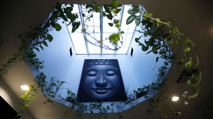 SHERMAN OAKS, CA - DECEMBER 28, 2017 -- A painting of Buddha hangs in a portal inside The Higher Pat