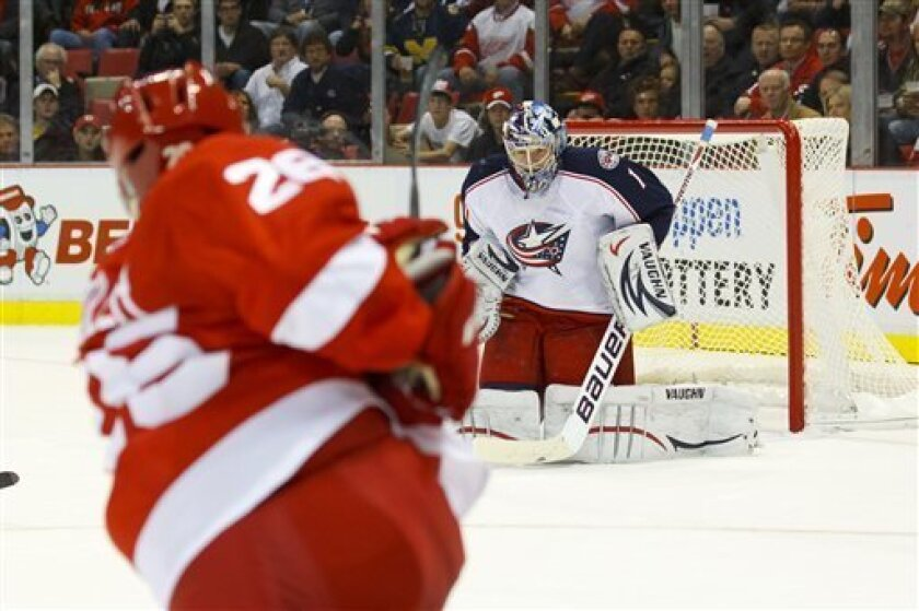 Columbus Blue Jackets goalie Steve Mason (1) makes a save on a shot by Detroit Red Wings right wing Tomas Jurco (28) in the second period of an NHL hockey game in Detroit, on Friday, Oct. 21, 2011. Detroit won 5-2.  (AP Photo/Rick Osentoski)