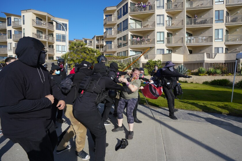 """Trump supporters gather in Pacific Beach for a """"Patriot March"""" and are met by anti-fascist counter-protesters Saturday."""