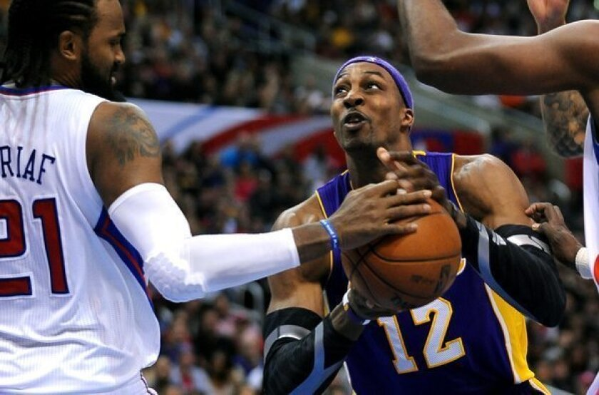 Lakers center Dwight Howard has the ball stripped by Clippers big man Ronny Turiaf.