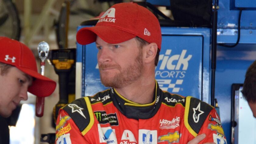 Dale Earnhardt Jr. stands in the garage during a practice for Sunday's NASCAR Cup Series auto race.