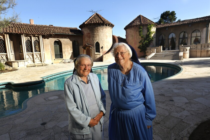 Sister Catherine Rose, left, and Sister Rita Callanan at the Sisters of the Immaculate Heart of Mary retreat in Los Feliz in 2015. The order made a deal to sell the property to restaurateur Dana Hollister, but the Archdiocese of Los Angeles says that only it has the authority to sell the property, which it intends to do to singer Katy Perry.