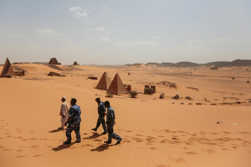 In this Thursday, April 16, 2015, photo, members of the Sudanese security forces guard the historic Meroe pyramids in al-Bagrawiya, 200 kilometers (125 miles) north of Khartoum, Sudan. The pyramids at Meroe are deserted despite being a UNESCO World Heritage site like those at Giza in Egypt. (AP Pho