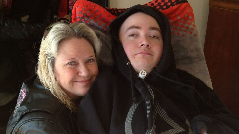 Brandon Maxfield with his mother Sue Stansberry in January in Willits.