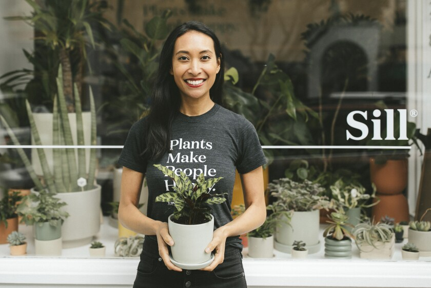 This May 30, 2019 photo provided by The Sill shows Eliza Blank outside The Sill's San Francisco shop. Blank, who founded The Sill in 2012, says people turned to plants when they realized they would be stuck at home due to COVID-19 concerns and isolated from others for much longer than expected. (Kelly Boitano/The Sill via AP