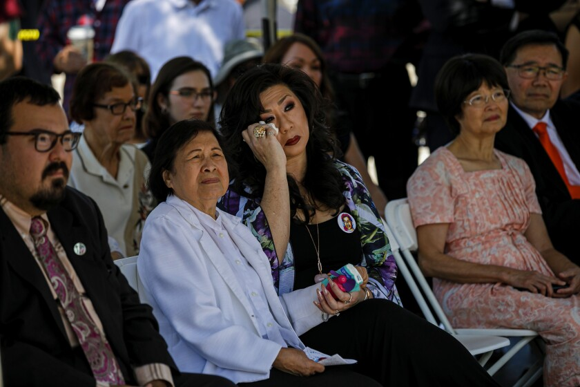 DEENA ILETO wipes her eye Saturday as she and her mother-in-law, Lilian, attend a remembrance ceremony for Lilian's son Joseph, who was killed by a white supremacist Aug. 10, 1999, in Chatsworth. The killing of her brother-in-law was a call to action, Deena says.