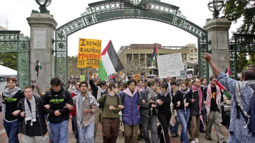 Pro-Palestinian demonstrators march through Sather Gate on the University of California, Berkeley campus in 2002.