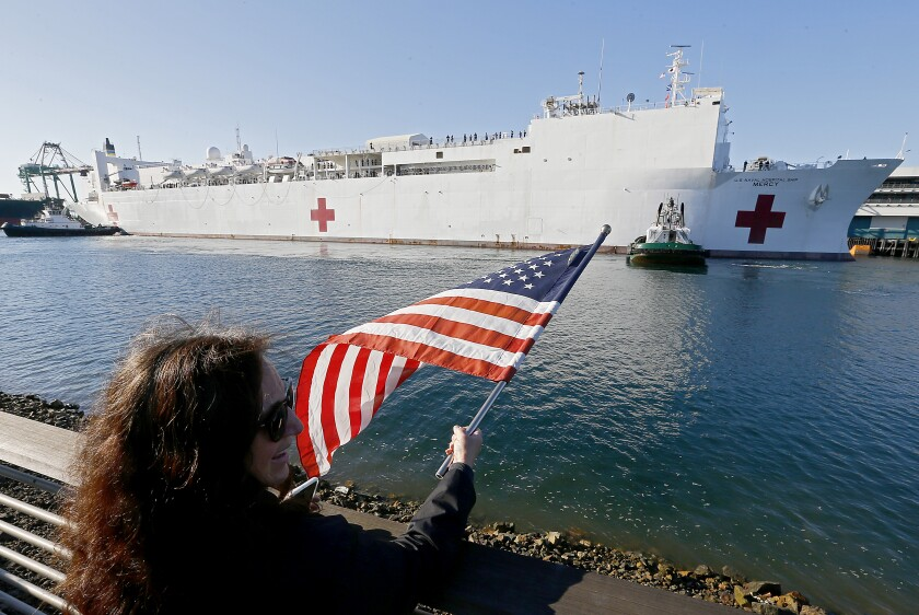 The Navy hospital ship Mercy arrives at the Port of Los Angeles on March 27. The vessel, which could provide an extra 1,000 beds, will not be used to treat COVID-19 patients but will accept patients with other medical issues in an attempt to relieve the burden on hospitals.