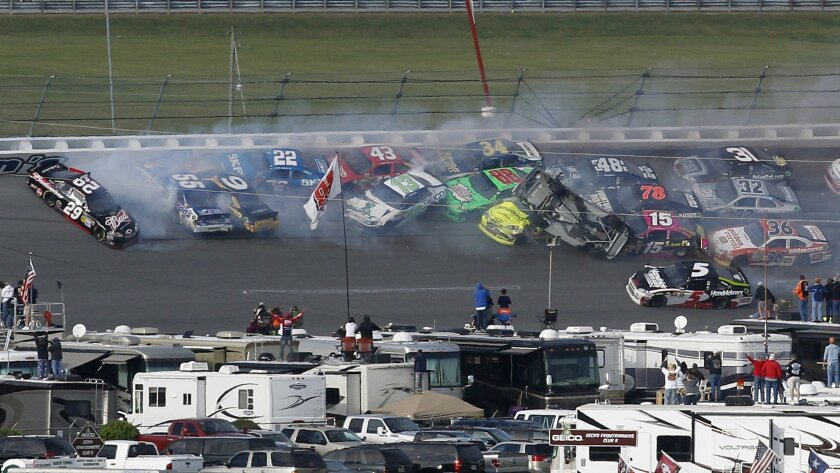 Race leader Tony Stewart (upside down) tried to block challengers on the final lap Sunday at Talladega but instead ended up wrecking most of the field, including himself.