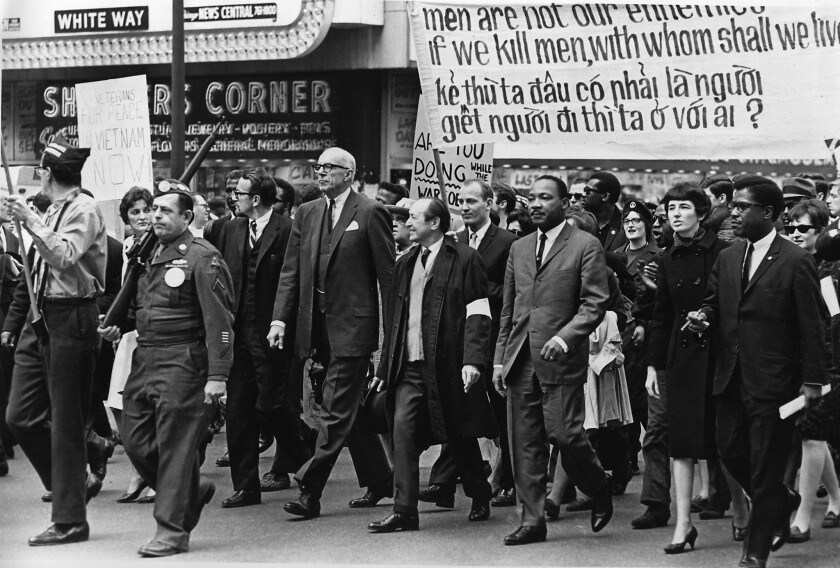 The Rev. Martin Luther King Jr., center right, marches in a protest against the Vietnam War with others including Dr. Benjamin Spock, tall, white-–haired man with glasses, in Chicago on March 25, 1967.