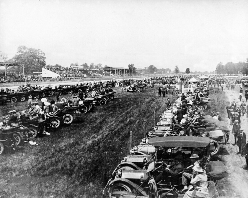 FILE - In this May 30, 1913, file photo, spectators watch the Indianapolis 500 auto race from their parked cars inside the infield of the Indianapolis Motor Speedway in Indiananpolis, Ind. (AP Photo/File)