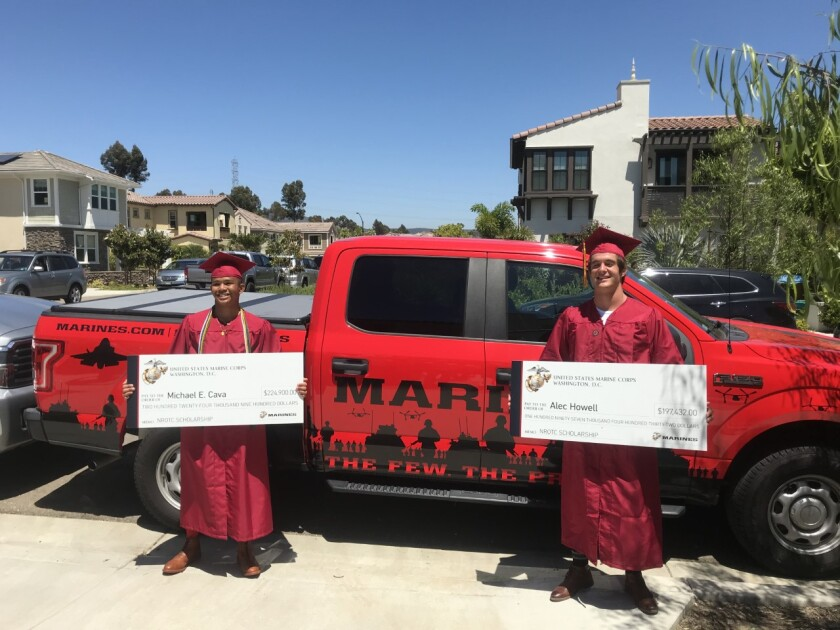 TPHS graduates Michael Cava and Alec Howell with their Marine Corps ROTC scholarships.