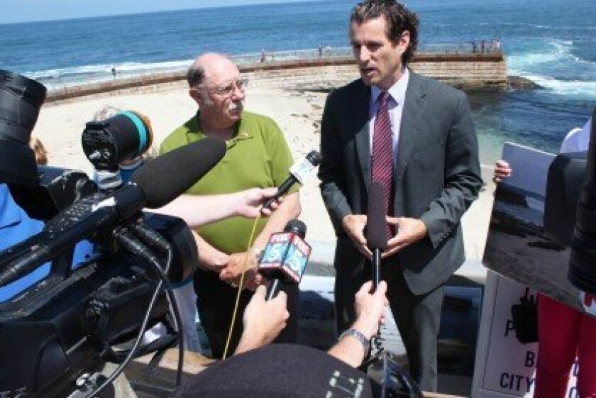 Public interest attorney Bryan Pease spoke with reporters during a press conference May 15, the day a rope barrier separating humans and seals was removed at the Children's Pool in La Jolla.