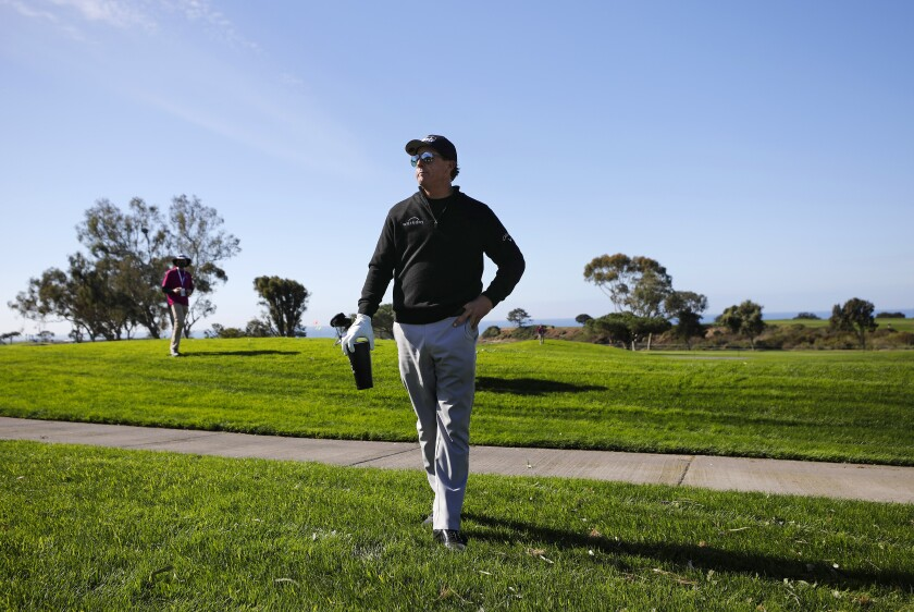 Phil Mickelson stands on the 18th hole during the Pro-Am at Torrey Pines in the Farmers Insurance Open last January.