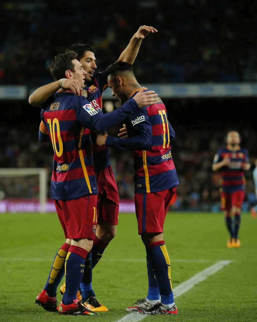FC Barcelona's Neymar, right, celebrates a goal with his teammates Luis Suarez, center, and Lionel Messi against Celta Vigo during a Spanish La Liga soccer match at the Camp Nou stadium in Barcelona, Spain, Sunday, Feb. 14, 2016. (AP Photo/Manu Fernandez)