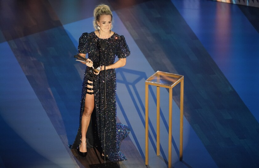 Carrie Underwood accepts the entertainer of the year award during the Academy of Country Music Awards.