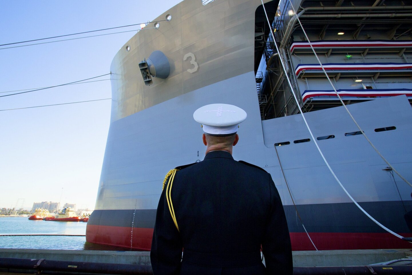 Following the christening of the USNS Lewis B. Puller (MLP 3 AFSB) a Marine walking by stopped for one last look at the Navy's newest ship named in honor of a U.S. Marine.
