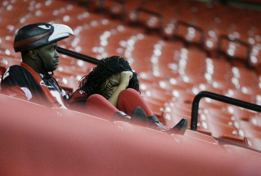 Atlanta Falcons watch the field after overtime of an NFL football game against the Tampa Bay Buccaneers, Sunday, Nov. 1, 2015, in Atlanta. The Tampa Bay Buccaneers won 23-20. (AP Photo/David Goldman)