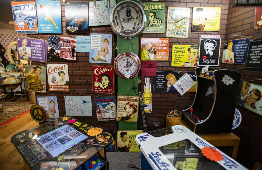 RIVERSIDE, CA - JUNE 22, 2019: Vintage signs, clocks and games are for sale at the Mission Galleria