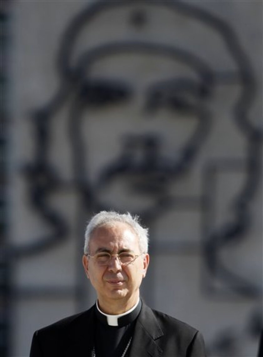 Vatican Foreign Minister Archbishop Dominique Mamberti attends a wreath-laying ceremony at the Jose Marti monument in Havana, Wednesday, June 16, 2010. Mamberti is in Cuba to to discuss the island's economic plight and meet with government authorities.  In the background is a depiction of Argentina