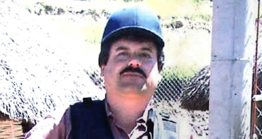 """Portion of a poster depicting Joaquin """"El Chapo"""" Guzman displayed at a Chicago Crime Commission news conference in 2013."""