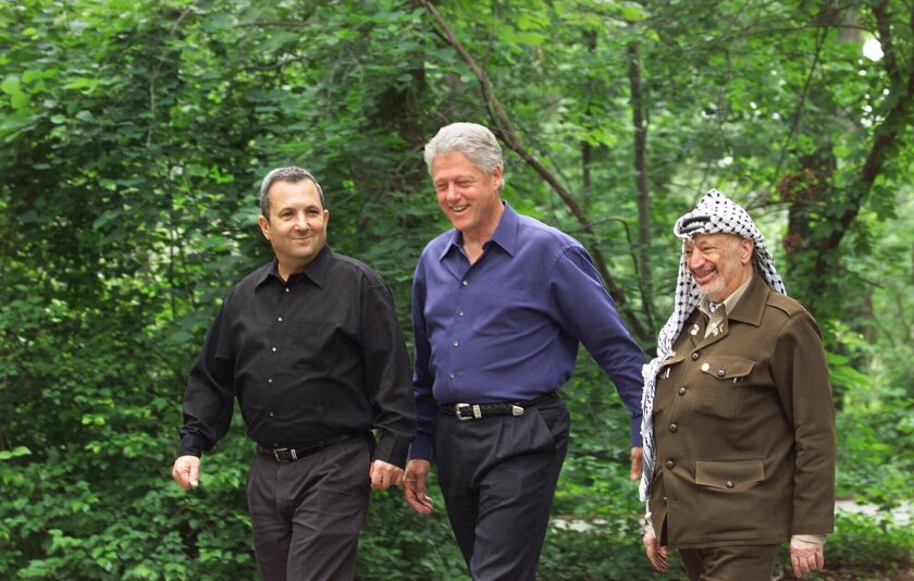 """FILE - President Bill Clinton, center, Israeli Prime Minister Ehud Barak, left, and Palestinian leader Yasser Arafat walk on the grounds of Camp David, Md., at the start of the Mideast summit on July 11, 2000. The documentary """"The Human Factor"""" shows the behind-the-scenes story of the U.S.'s effort to secure peace in the Middle East. (AP Photo/Ron Edmonds, File)"""