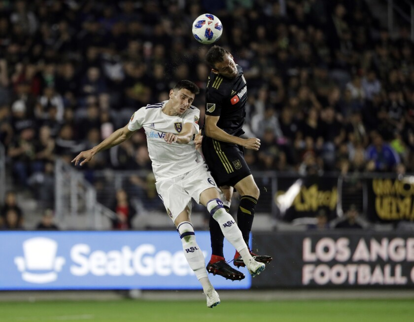 Los Angeles FC's Danilo Silva, right, heads the ball next to Real Salt Lake's Damir Kreilach (6) during the first half of an MLS soccer playoff match Thursday, Nov. 1, 2018, in Los Angeles.