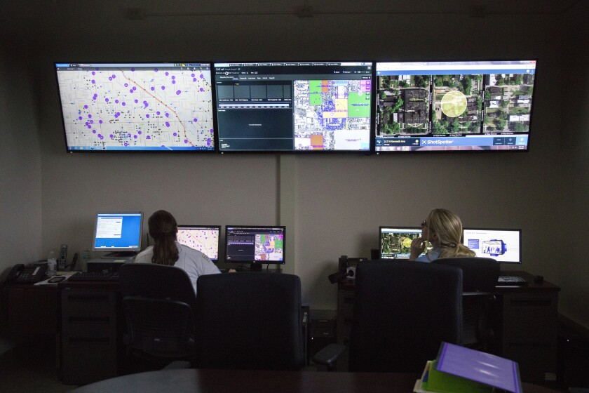 """FILE - In this Wednesday, Feb. 8, 2017 file photo, members of the Chicago Police Department work with new predictive and tracking """"ShotSpotter"""" technologies in a strategic decision support center at the Chicago Police Department 11th district headquarters in Chicago. In a Monday, May 3, 2021 court filing, community groups argue the gunshot detection system routinely reports gunshots where there are none, sending officers into predominantly Black and Latino neighborhoods for """"unnecessary and hostile"""" encounters. (Erin Hooley/Chicago Tribune via AP)"""