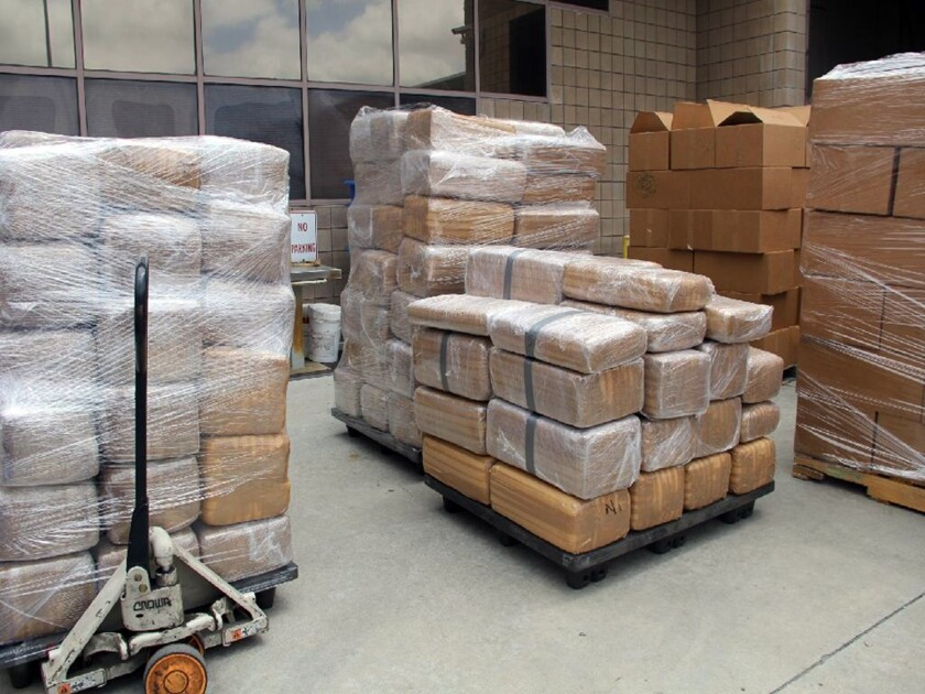 Customs officers found 587 wrapped packages of marijuana with a street value of $7.1 million, authorities said.