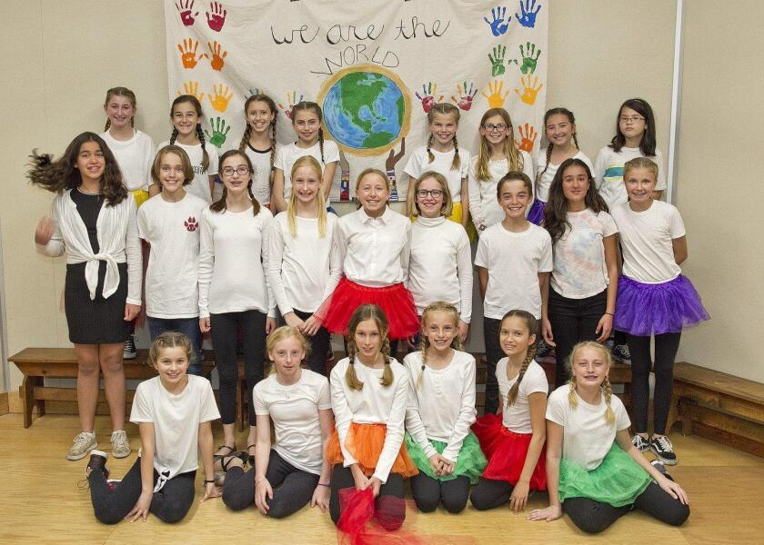 """Sixth graders opened the show with a performance of """"We Are the World"""""""