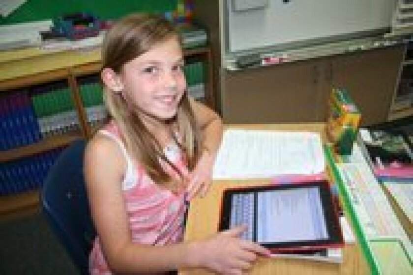 Fourth grader Kennedy Quay works on her iPad at Del Mar Heights. Photo/Karen Billing