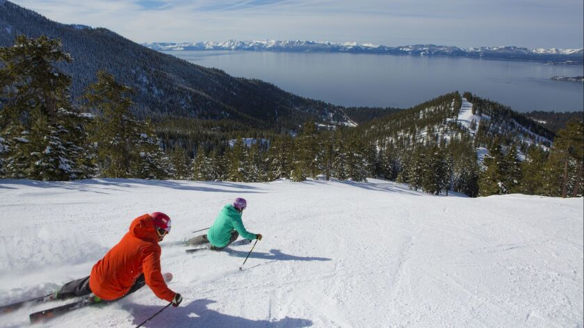 INCLINE VILLAGE, NEV. -- Lake Tahoe looms large for a pair of skiers headed back down Diamond Peak.