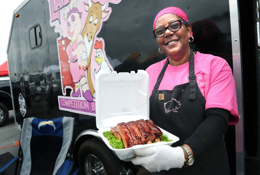 Sylvie Curry (Lady of Q) holds ribs that she is entering in a barbecue contest at the Queen Mary in Long Beach.