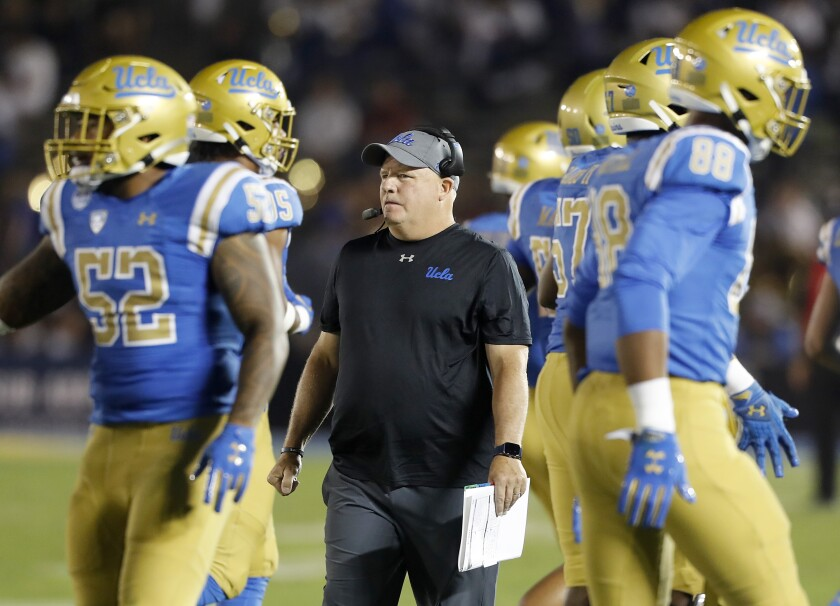 UCLA football coach Chip Kelly watches his Bruins play a game last season.