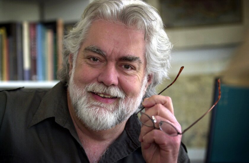 """FILE - In this April 29, 2004, file photo, Gunnar Hansen poses at his home in Northeast Harbor, Maine. A spokesman says Hansen, who played the iconic villain Leatherface in the original """"Texas Chain Saw Massacre,"""" died Saturday, Nov. 7, 2015, of pancreatic cancer. He was 68. (AP Photo/Robert F. Buk"""