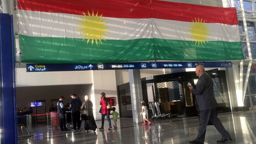 A Kurdish flag hangs in the Irbil International Airport, in Iraq, Wednesday, Sept. 27, 2017. Iraq's