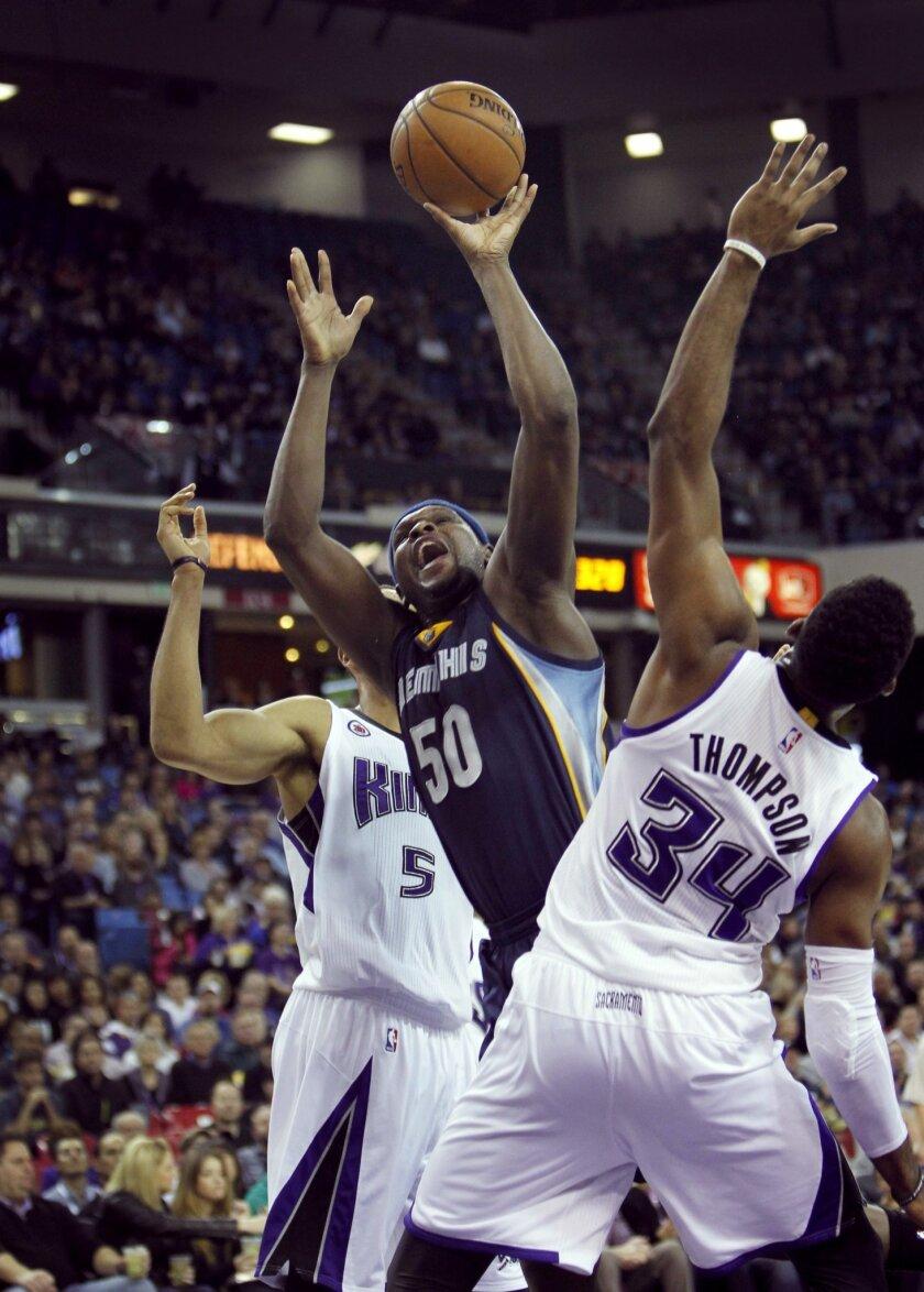 Memphis Grizzlies forward Zach Randolph (50) shoots over Sacramento Kings defender Jason Thompson (34) during the first half of an NBA basketball game in Sacramento, Calif., on Sunday, Nov. 30, 2014.(AP Photo/Steve Yeater)