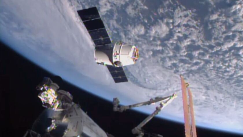 FILE - In this April 17, 2015, file image from NASA-TV, the SpaceX Dragon 6 resupply capsule nears t
