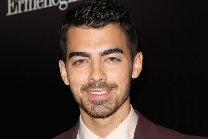 """Joe Jonas tells New York magazine that when the show """"Jonas"""" was done, he cut his hair and grew as much of a beard as he could."""