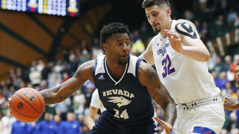 Nevada forward Jordan Caroline (left) drives against Colorado State center Nico Carvacho during the Wolf Pack's 98-82 win earlier this month.