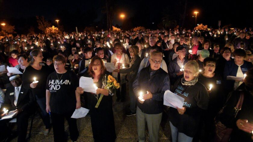 Candle light vigil at Temple Adat Shalom