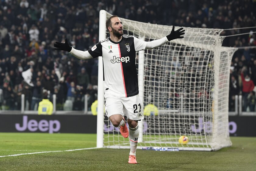 Juventus' Gonzalo Higuain celebrates after scoring during the Italian Cup soccer match between Juventus and Udinese, at the Allianz Stadium in Turin, Italy, Wednesday, Jan. 15, 2020. (Fabio Ferrari/LaPress via AP)