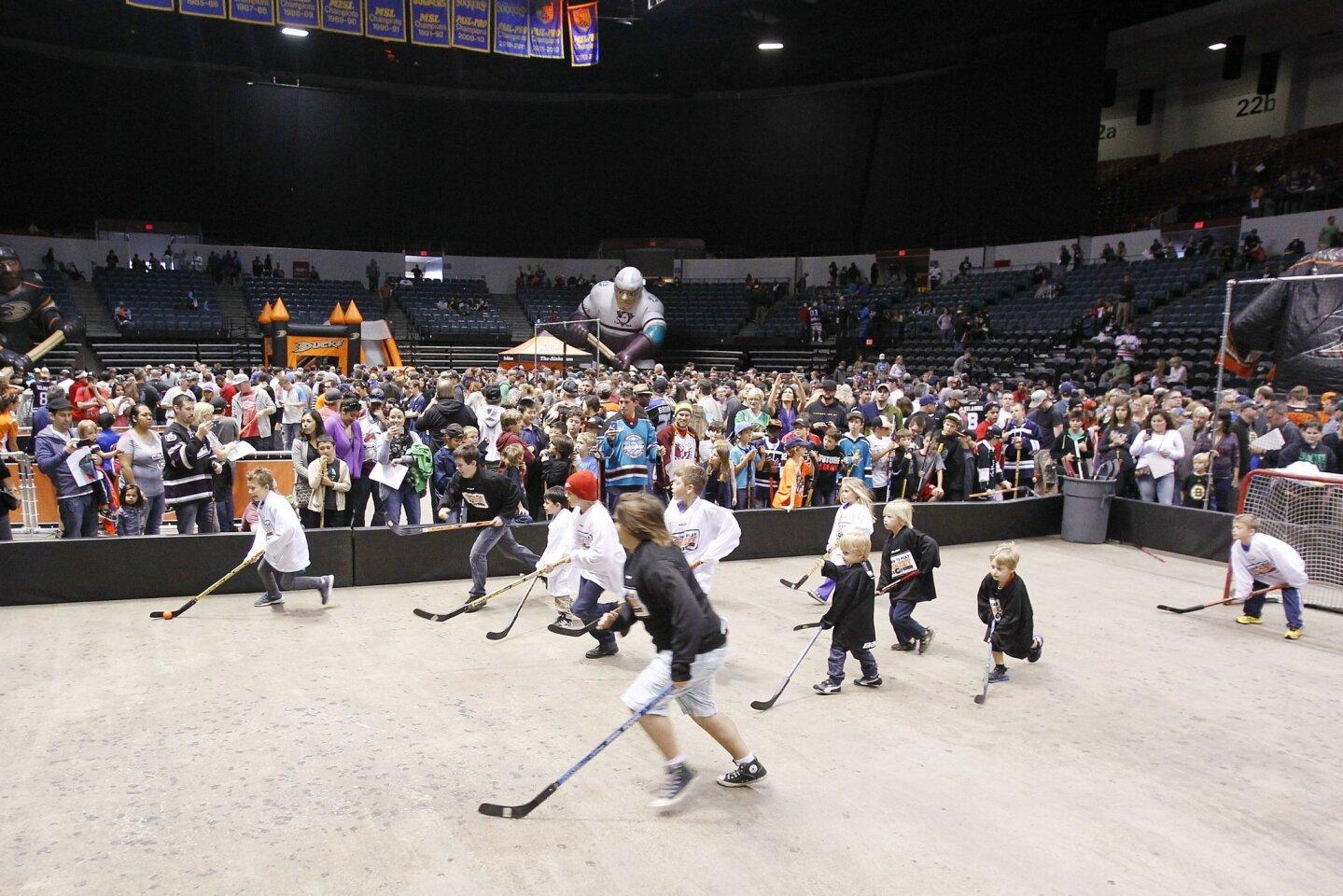 "Children play hockey at ""HockeyFest"", an event put on by the Anaheim Ducks promoting the club's AHL San Diego Gulls."