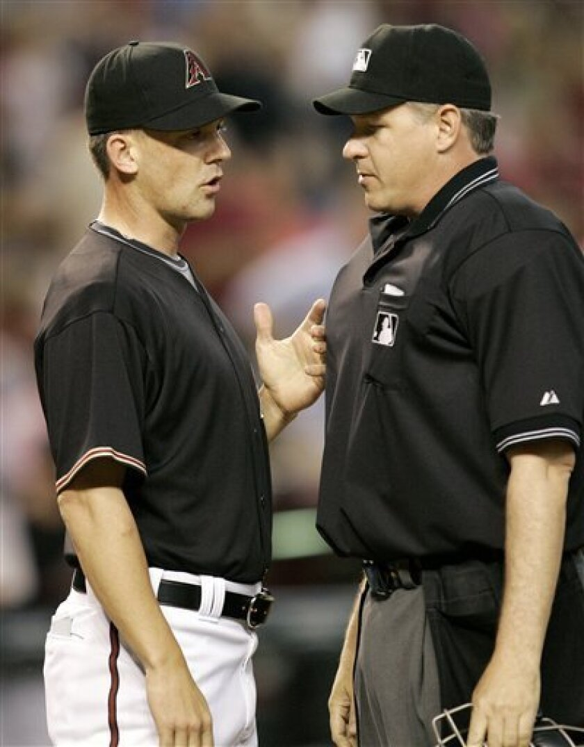 Arizona Diamondbacks manager A.J. Hinch argues with home plate umpire Paul Emmel during the seventh inning of a baseball game in Phoenix, Saturday, May 9, 2009. (AP Photo/Matt York)