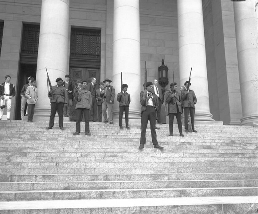 A group of Seattle Black Panthers, led by Elmer Dixon, stand on the steps of the Washington state Capitol in Olympia in February 1969 to protest a bill that would make it a crime to exhibit firearms in the state.