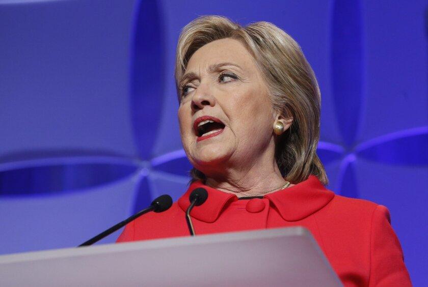 Democratic presidential candidate, Hillary Clinton speaks at the state's Democratic-Farmer-Labor (DFL) Humphrey-Mondale dinner, Friday, Feb. 12, 2016, in St. Paul, Minn  (AP Photo/Jim Mone)